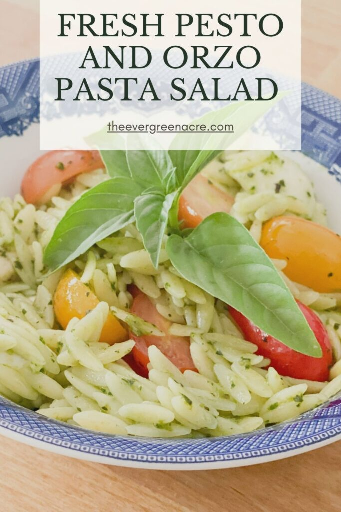 pesto orzo salad in blue and white bowl text overlay